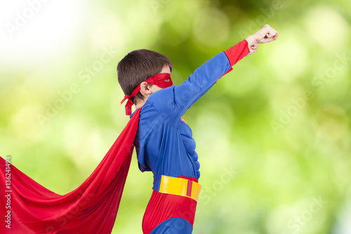 child with costume of superhero and the arm up Wallpaper Mural