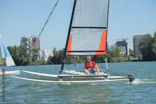 Poster Zeilen sailing on a lake - summer and sports theme