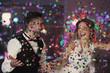 canvas print picture - Cute happy wedding couple against defocused lights