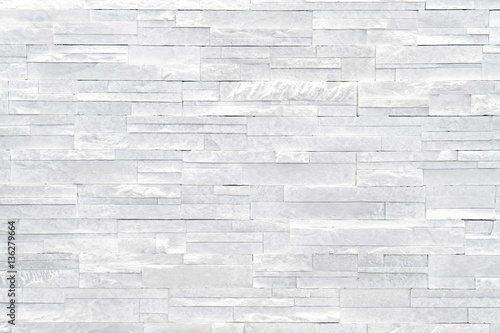 Papiers peints Cailloux White stone wall background. Stacked stone tiles are often used in interior design decors as accent wall. Use this gray texture in graphic design to create a wallpaper, background, backdrop and more!