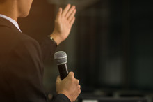 Blurred Of Smart Businessman Speech, Talking With Microphone, Gr