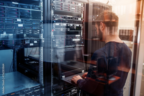 Fototapeta network engineer working in server room obraz