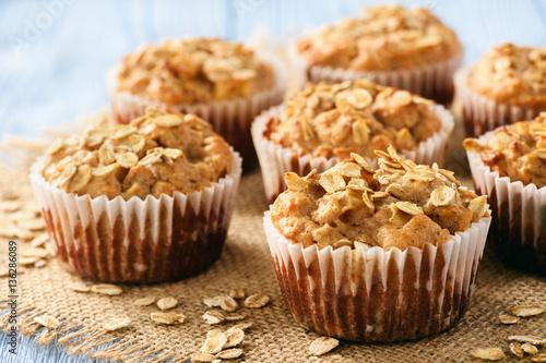 Obraz na płótnie Oat muffins with apples and cinnamon.