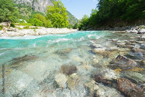 Foto auf Gartenposter Fluss Mountain river with clean blue water. Selective focus.