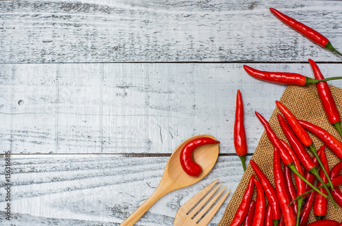 Hot and spicy red chilli on wood table background Canvas Print