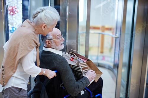 Valokuva  Senior woman taking care of her disabled husband during shopping