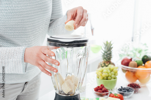 Woman using a blender