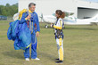 woman thanks instructor after tandem skydive