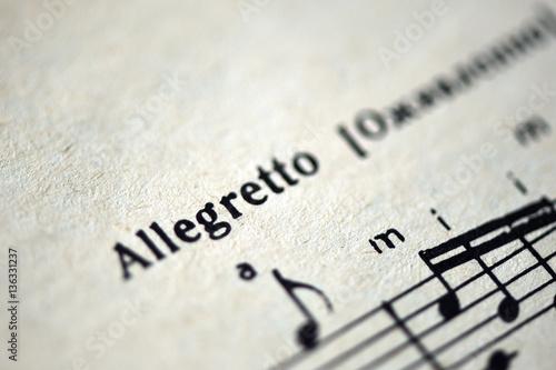 Photo Musical tempo Allegretto in a music book close up