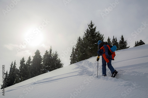 3fd5d49f8c Man standing at top of ridge. Ski touring in mountains. Adventure ...