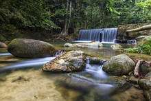A Beautiful Waterfall Inside Tropical Rainforest. Long Exposure And Slow Shutter