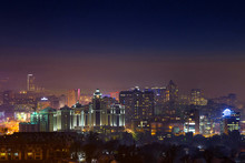 Night Over Almaty.  Night View Of The City Of Almaty At Night Time. Distant Buildings Are Covered With Fog.