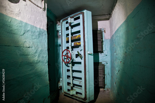 Photo  Hermetic door of an abandoned Soviet bomb shelter, an echo of the Cold War