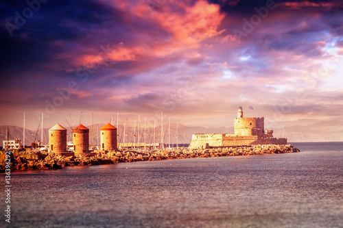 Beautiful seascape. Sunset at the port in the old town of Rhodes