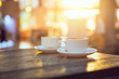 canvas print picture - coffee in the morning, two cup of espresso on wood table in cafe or coffeeshop.