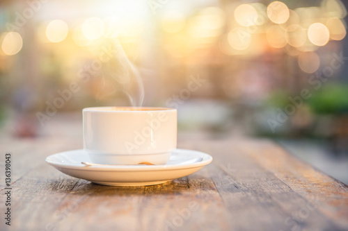Obraz smoke hot drink coffee cup in the morning on wooden table. - fototapety do salonu