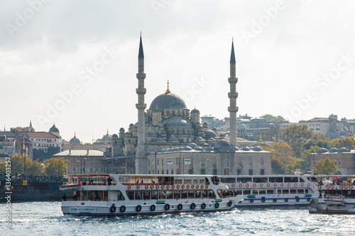 Sunny view of Bosphorus with excursion boats and Blue mosque, Istanbul, Turkey Poster