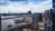 4k Timelapse Top View of Hong Kong Cityscape day whit clouds, skyline of the city near Kowloon Bay with ships and cars in freeway front the Harbour -Dan