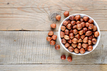Hazelnuts In Bowl On Wooden Table Top View