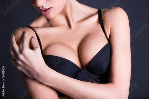 Obraz na plátne close up of female breast in black lace bra