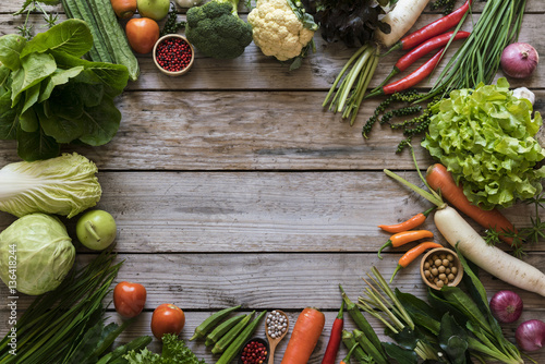 Valokuva  Fresh farmers market fruit and vegetable from above with copy sp