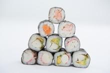 Maki Sushi Arranged On White Background