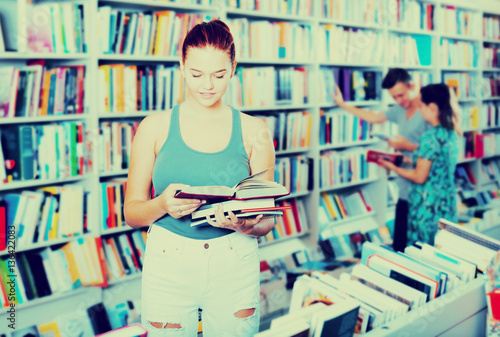 Girl holding open book in hands Poster