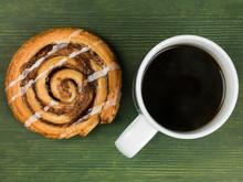 Cinnamon Swirl Danish Pastry With A Mug Of Black Coffee