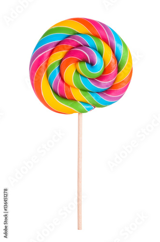 Photographie Colorful rainbow lollipop swirl on wooden stick isolated on white background