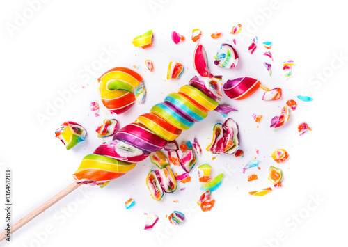Foto op Aluminium Snoepjes Shiny rainbow colorful crushed sweet candy lollipop isolated on white background