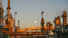 Refinery Storage Tanks Against Clear Sky During Sunset