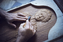 Cropped Image Of Man Carving I...