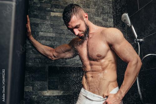 Muscle guy taking shower