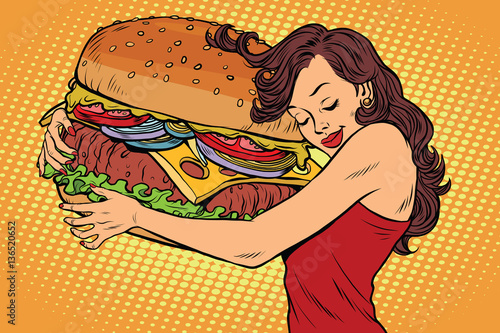 Beautiful young woman hugging Burger
