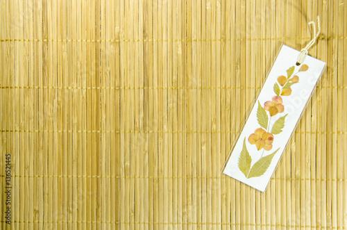 Handmade dried flower bookmark on the bamboo background craft art handmade dried flower bookmark on the bamboo background craft art use for texture and mightylinksfo