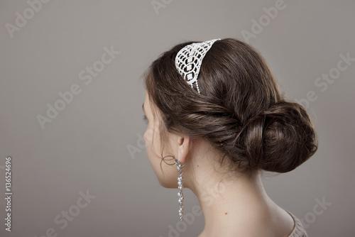 Fototapeta head of woman with hair in bun on gray isolated background obraz na płótnie