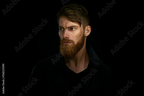 Closeup portrait of bearded handsome man in a pensive mood looki Poster