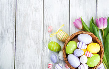 Basket With Easter Eggs And Tu...