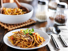 Spaghetti Pasta Dinner On Plate With Meat Sauce And Oregano