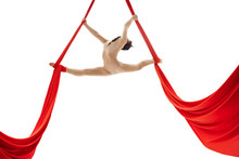 Young Girl Doing Splits On Aerial Silks In Studio