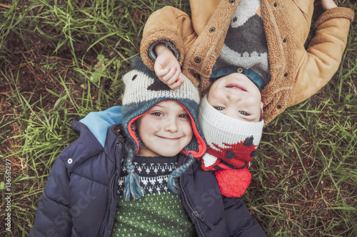 Two boys wearing wooly hats lying in grass - Buy this stock photo ... 747e27795dec