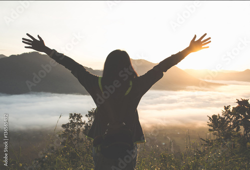 Fotografie, Tablou  successful woman hiker open arms on mountain