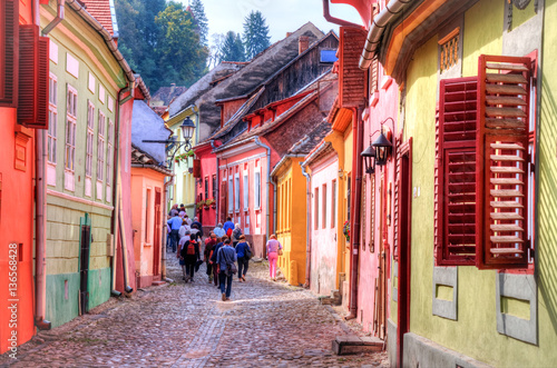 Tourists walking inside the famous citadel of Sighisoara in a summer holiday, Tr Fototapet