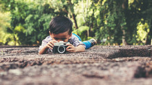 Little Boy With A Vintage Camera
