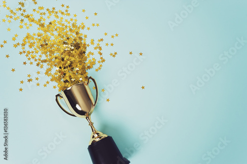 Photo gold winner cup on blue  background