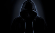 Hooded Hacker In Dark