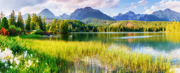 Fototapeta Popularne Majestic mountain lake in National Park High Tatra. Strbske ples