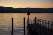 Orange sunset and jetty on Lake Geneva
