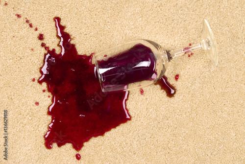 Fotografering  Spilled wine on carpet