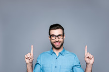 Portrait Of Young Cheerful Bearded Man In Glasses Gesturing Up